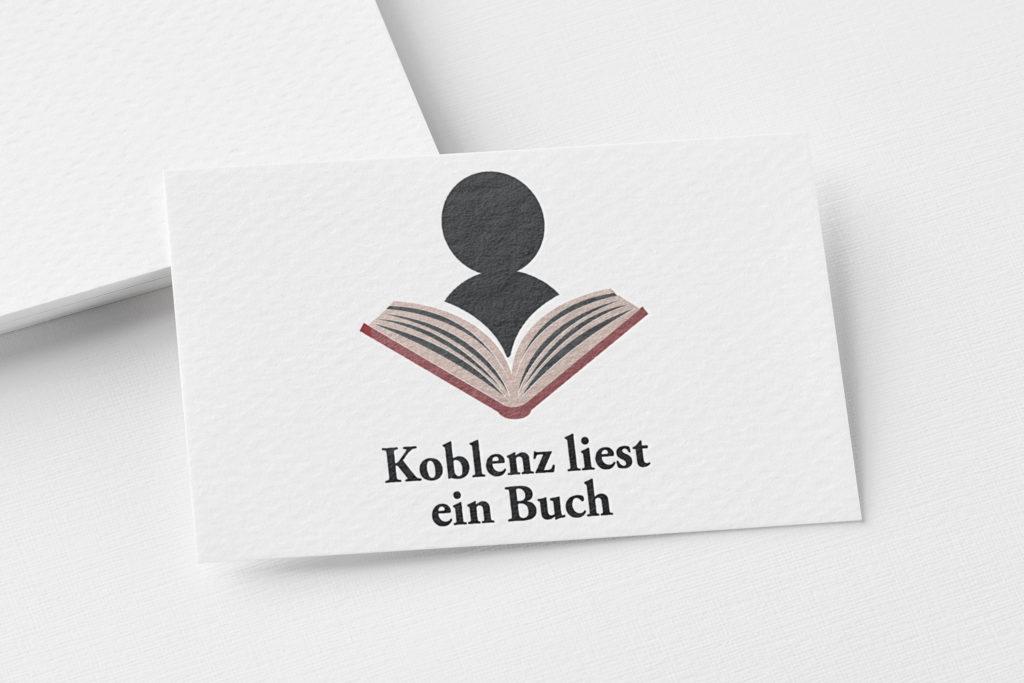 Mokeup Logo Koblenz liest ein Buch